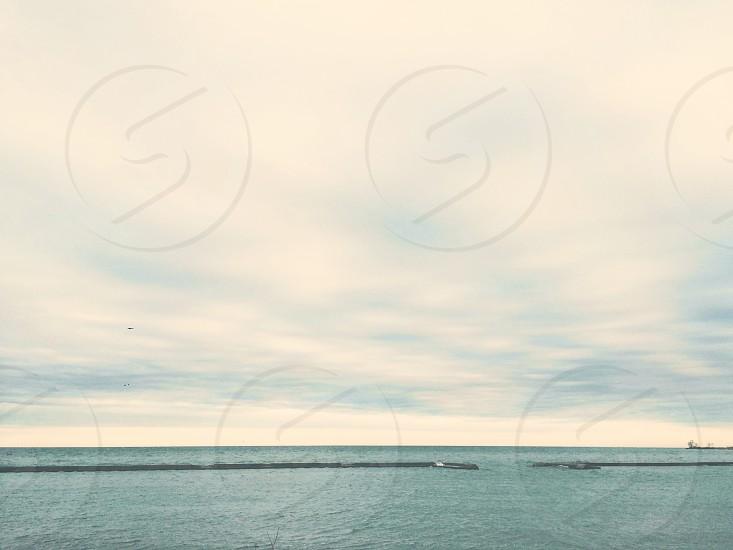 water beach overcast shore horizon blue aqua lake photo
