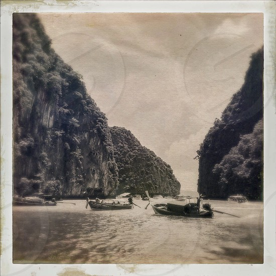 Outdoor day black and white monochrome sepia filter square Krabi province phi Phi Islands Thailand Thai Kingdom sea ocean water boats limestone cliffs pretty picturesque green greenery foliage blue sky long-tail travel wanderlust tourist tourism transport Summer holiday tradition traditional culture photo