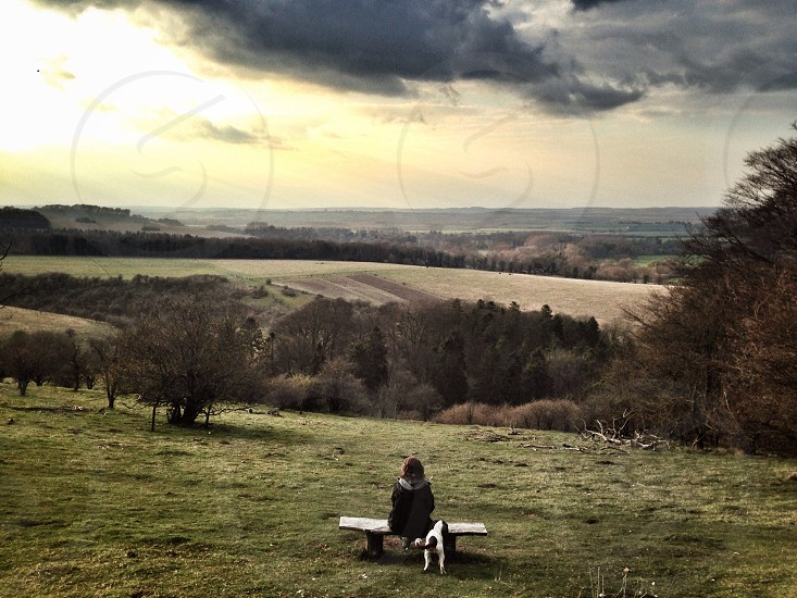 View viewpoint countryside national trust bench girl lady dog walker adventure isolated alone desolate horizon landscape photo
