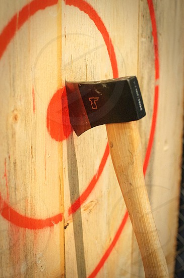 Axe wood throw target bullseye yellow red thrown accurate accuracy sharp blade wedge cut photo