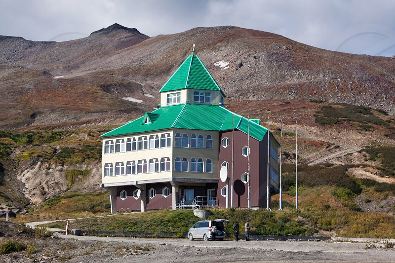 MUTNOVSKY VOLCANO KAMCHATKA PENINSULA RUSSIA - SEP 21 2011: Hotel building for power plant personnel tourists and travelers located on territory of Mutnovskaya Geothermal Power Station. Eurasia Russian Far East Kamchatka Region. photo