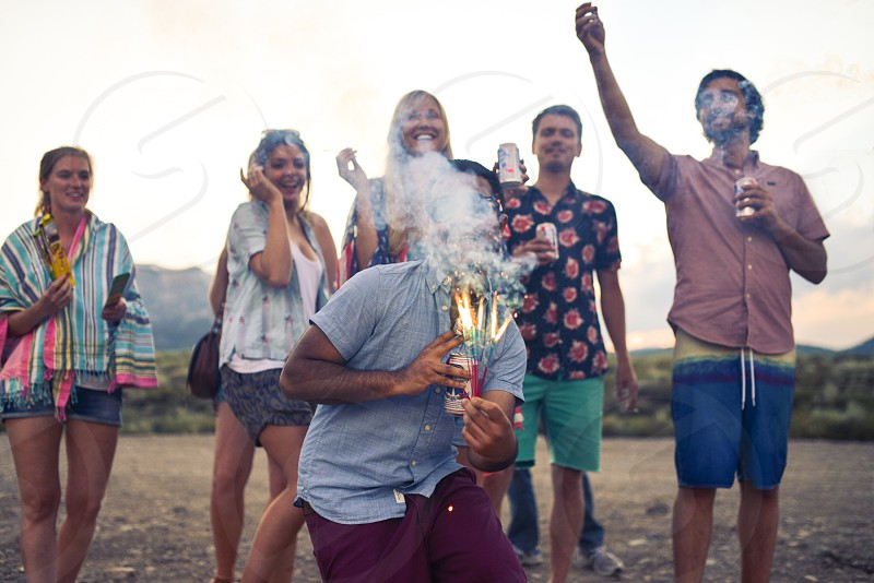 People celebrating on the beach with sparklers photo
