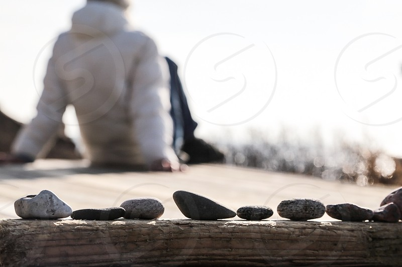 I collect different shades of grey stones photo