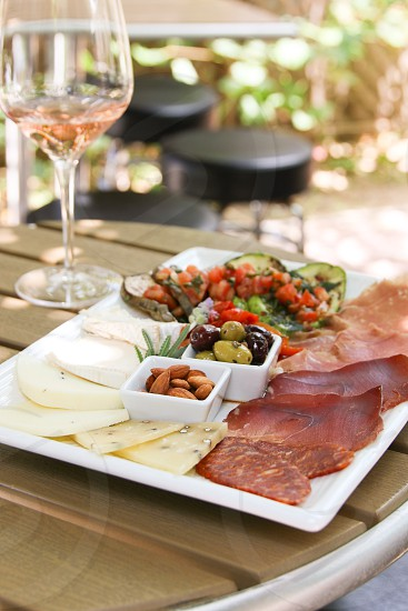 Antipasto and rose on patio photo