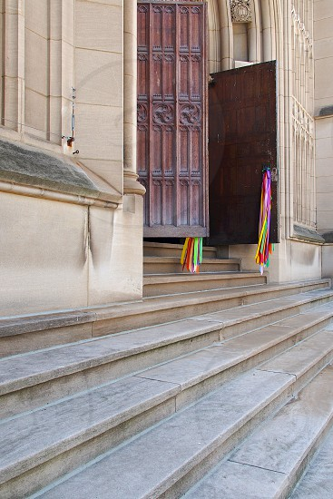 Sone Steps. Stairs. Cathedral. Wooden Doors. Wood. Carving. Old. Ribbons. Colorful. Entrance. Doorway. Door. Open. Faith.  photo