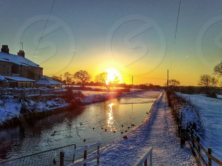 Sunset Winter reflections Leeds to Liverpool Canal United Kingdom photo