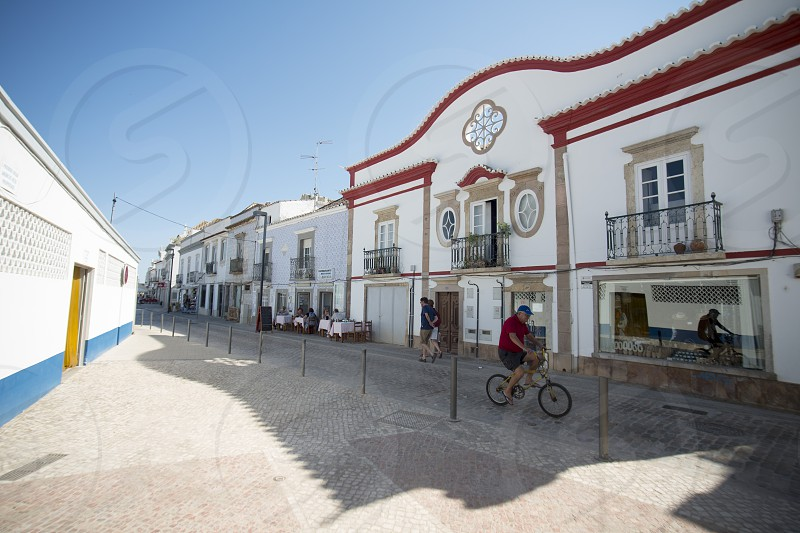 a street in the old town of Tavira at the east Algarve in the south of Portugal in Europe. photo