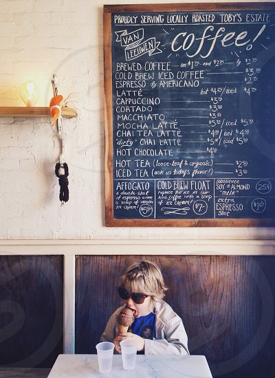 child eating ice cream at a coffee shop photo