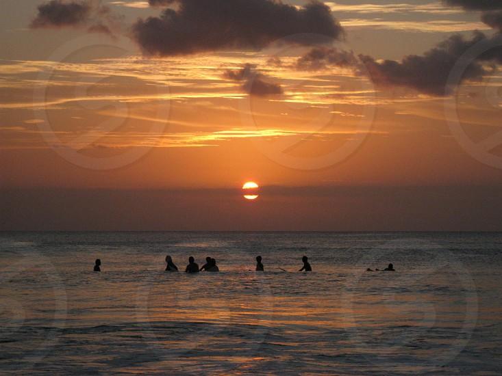 Bali surfers at sunset photo