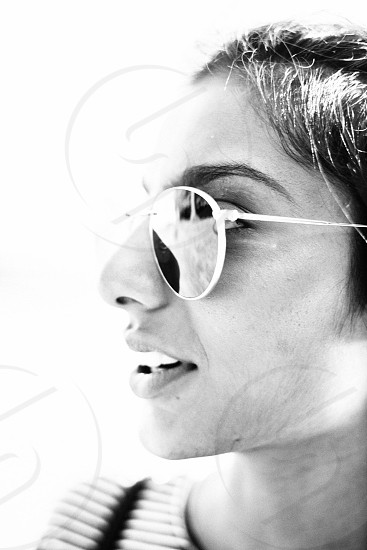 grayscale photography of woman portrait with sunglasses photo
