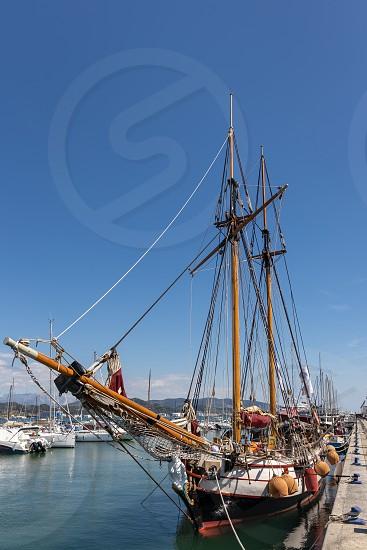 LA SPEZIA LIGURIA/ITALY  - APRIL 19 : Old sailing clipper moored in La Spezia Liguria Italy on April 19 2019. Four unidentified people photo