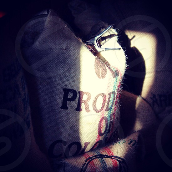 bags of coffee in silhouette local coffee shop photo