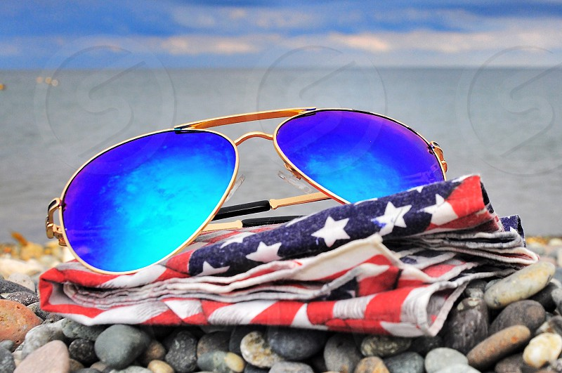 gold framed blue flash lens aviator sunglasses photo
