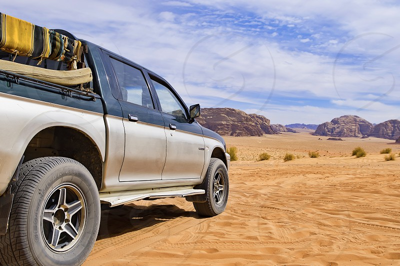 Jordan car desert travel jeep Sky clouds photo