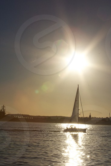 black and grey sailboat sailing photo