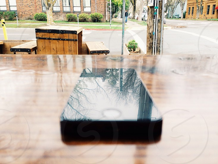 Black apple iphone on wooden surface photo