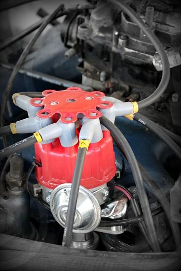 Distributor and leads engine rebuild car parts fixing car distributor cap v8 engine photo