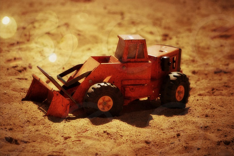 Summer Construction - Vintage digging truck in sand and sunshine photo