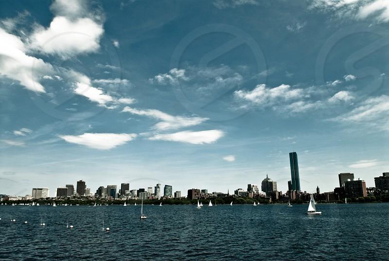 white sail boat on blue sea photo