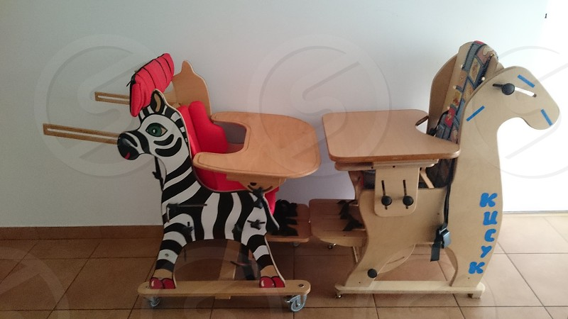 toddler's two brown and black animal theme wooden high chairs photo