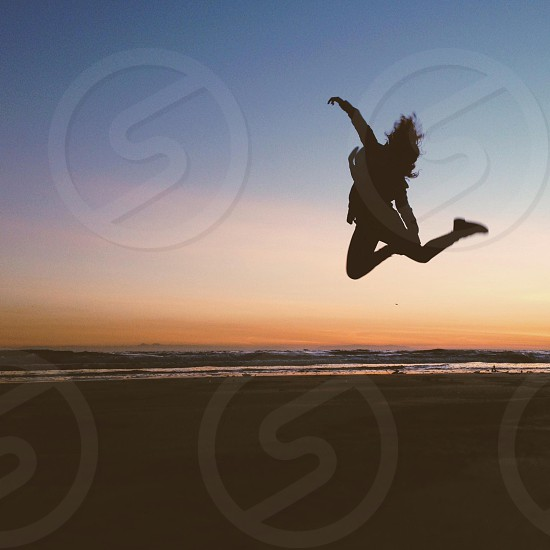 woman jumping silhouette photo