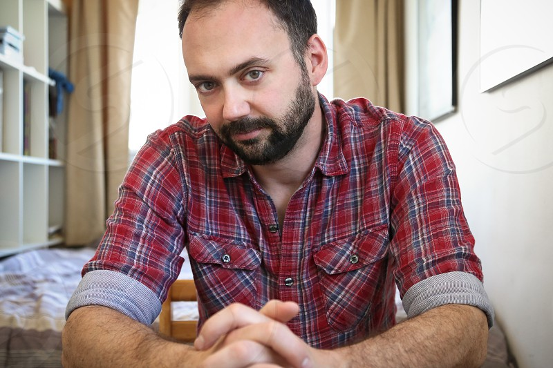 man in red and blue plaid button down shirt photo