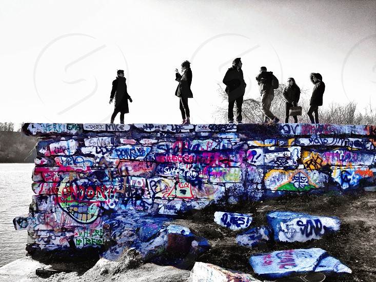 six silhouette on a graffiti wall  photo