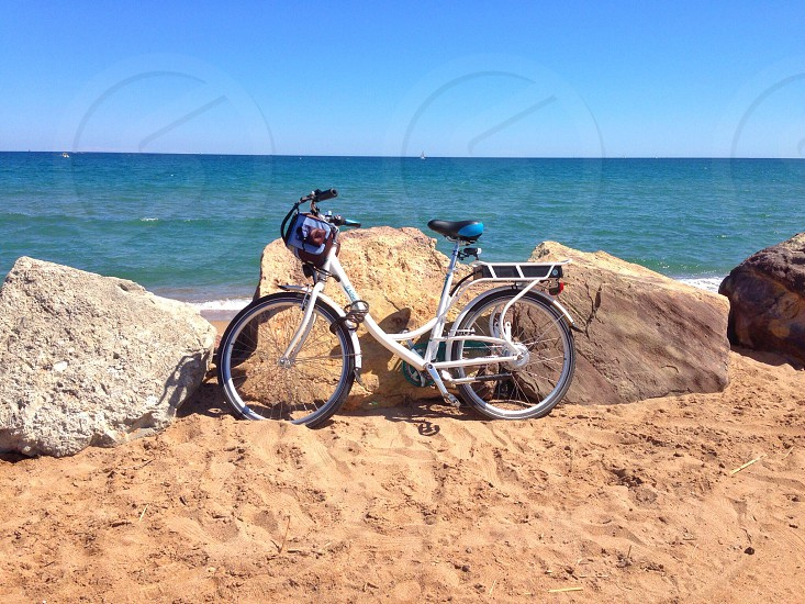 Circles bicycle wheels beach sea photo