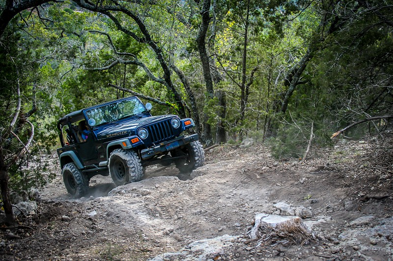 adventure vehicle Jeep 4x4 off-road trail rock dirt trees country backcountry hill climb photo