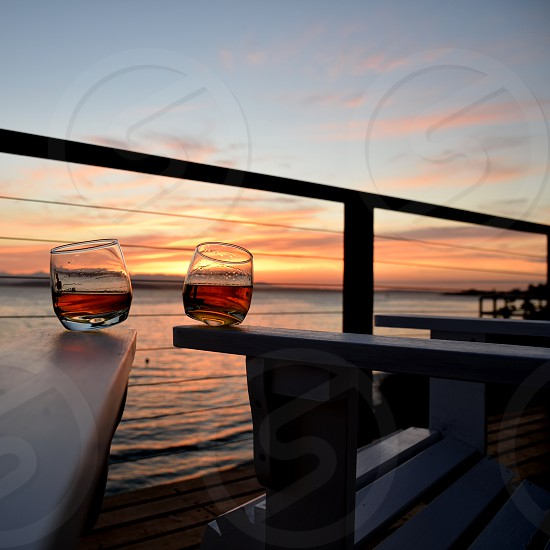 Whiskey sunset seashore chair arms photo