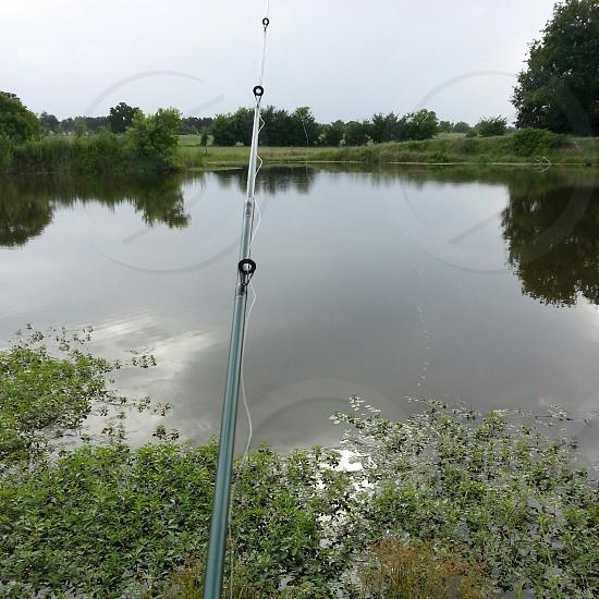 Fishing fishing pole pond overcast photo