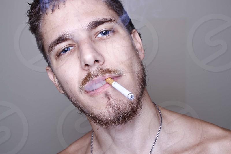 Male model smoking. photo