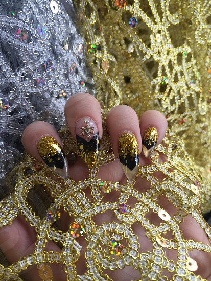 gold and black french tip manicure photo