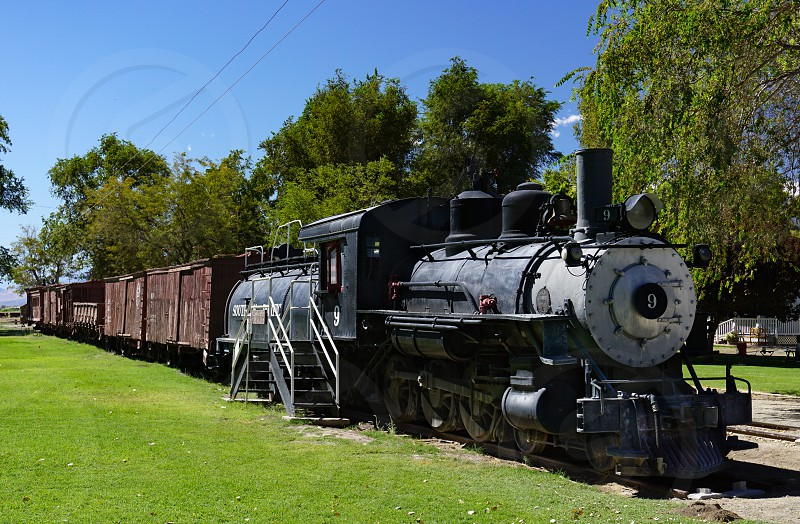 Historic narrow gauge railroad train in Laws California includes locomotive 9 a Baldwin 4-6-0 oil fueled steam engine built in 1909. photo