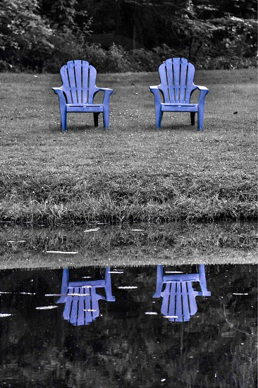2 blue wooden adirondack chairs photo