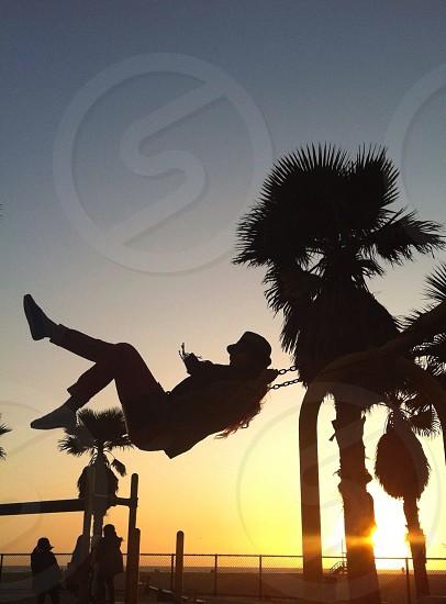 woman swinging photo