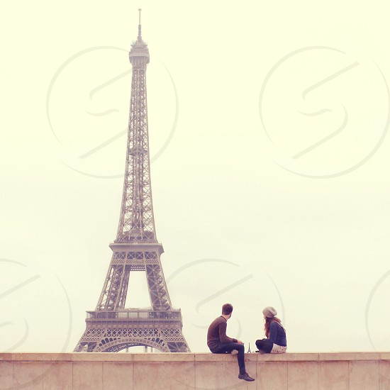 """Conversation among friends in France""  - Paris friends conversation tour Eiffel day sunset boy girl France photo"