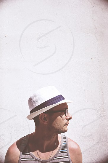 guy fedora glasses white wall santorini greece profile photo