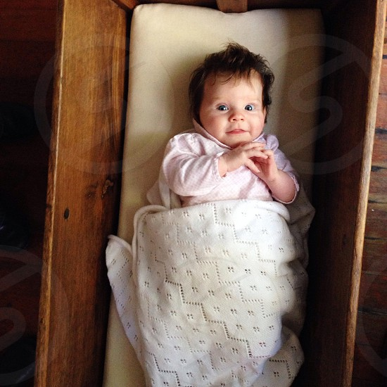 infant in crib smiling photo