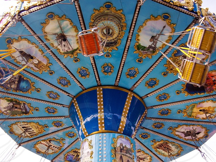 Carousel fun joy happiness life round circle circles swing tivoli colorful gold golden old fashioned vintage beautiful old colorful blue turquoise ornament ornaments carousels happy joyful  photo