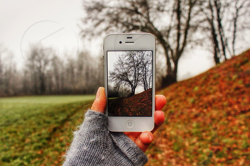 person holding a white iphone 4s photo