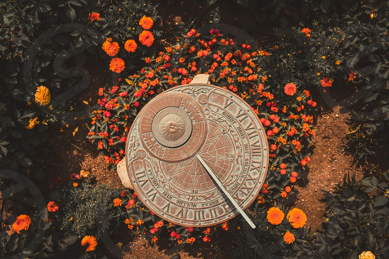 looking down upon a sundial in the garden photo