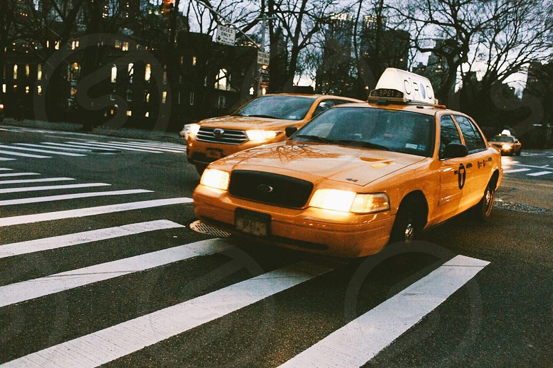 orange taxi cab on the street photo