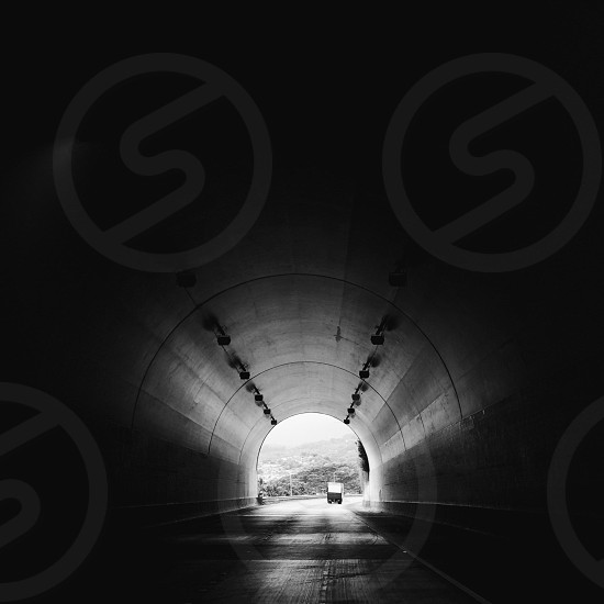 black and white truck in tunnel photo