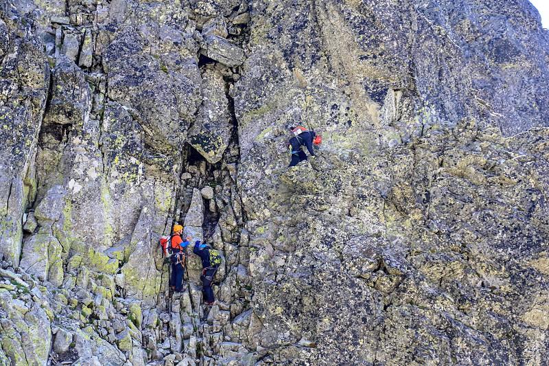 Climbing a mountain in Slovakian Tatra mountains photo