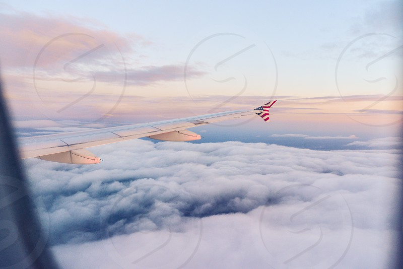 airplane air travel travel clouds america sunset photo