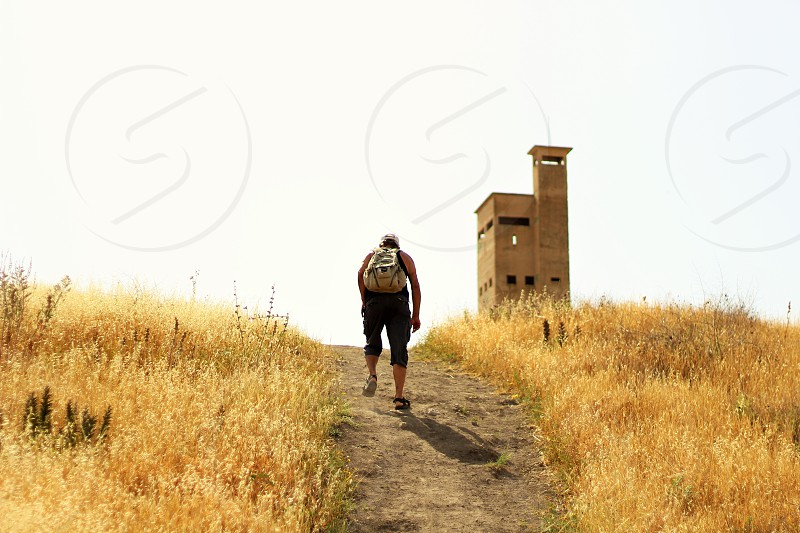 man wearing black tank top hiking photo