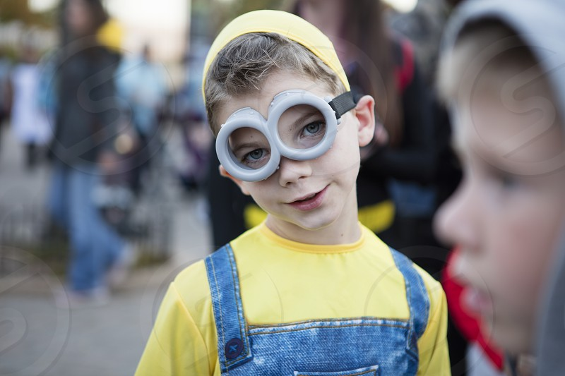 Kid dressed up for Halloween in costume photo