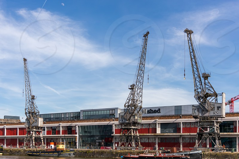 BRISTOL UK - MAY 13 : View of Electric Cranes by the River Avon in Bristol on May 13 2019. Unidentified people photo