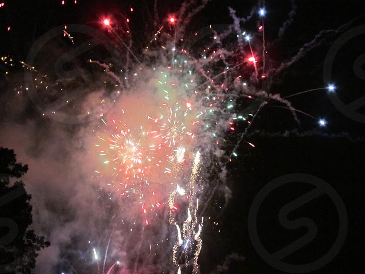 Fireworks in the dark sky photo